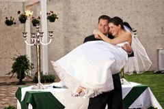 Groom lifting bride laughing Stock Image