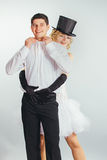 Groom lifts in arms blonde bride. Strong handsome groom lifts in arms young blonde bride in stylish wedding clothes Royalty Free Stock Photography