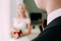 The groom look at his beautiful bride. Wedding. View from behind the shoulder. Selective focus Royalty Free Stock Photo