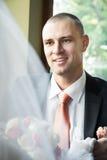 Groom looking at bride Stock Photo