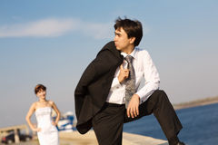 Groom looking forward on the embankment Royalty Free Stock Photography