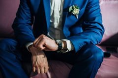 Groom looking at his watch expectation. Wedding Stock Photos