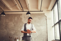 Groom looking at the wristwatches. Groom in vest and shirt looking at the wristwatches Royalty Free Stock Photography