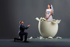 Groom makes the proposal, bride in the shell Stock Photo
