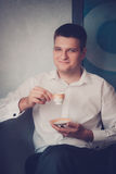 The groom or man holds a cup of coffee Royalty Free Stock Image