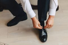 Groom meeting, details, jacket, shoes, watches and buttons on the wedding day stock image