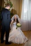 Groom meets bride Stock Photos