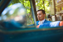 Groom in Old Car. Portrait of groom in blue car Stock Images