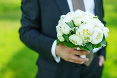 Groom with peonies bouquet Royalty Free Stock Photos