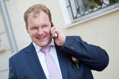 Groom on the phone Royalty Free Stock Photos