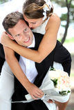 Groom pickaback his bride Royalty Free Stock Photography