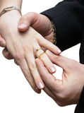 Groom placing ring on finger of bride Royalty Free Stock Photography