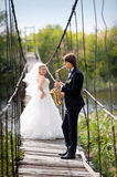 Groom playing for bride on their wedding day Royalty Free Stock Photo