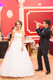Groom playing a flute for his bride. Wedding party Royalty Free Stock Photos