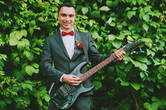 Groom playing the guitar Royalty Free Stock Photo