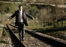 Groom portrait. Groom walking over the railways Stock Images