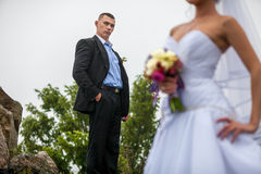 Groom portrait with bride in blur background Stock Photo