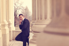 Groom posing near architectures Royalty Free Stock Photo