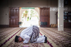 The Groom Praying. A Malay groom performing a prayer after solemnization Royalty Free Stock Photography