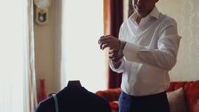 Groom prepares for wedding stock footage