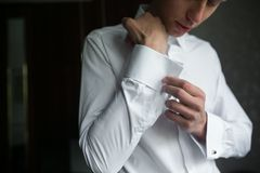 Groom prepares for wedding Stock Image