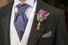 Groom with purple flower buttonhole Stock Photo