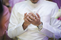 GROOM PUT HIS HAND TO PRAY DOA. Royalty Free Stock Photos