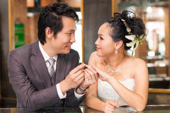 Groom Put Wedding Ring on bride Royalty Free Stock Images