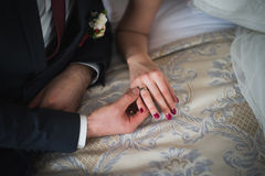 Groom puts  the RING on the finger bride Stock Image