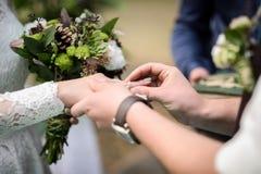Groom puts wedding ring Royalty Free Stock Photos