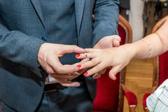 Groom puts wedding ring on bride`s finger. In wedding ceremony. Close up stock images