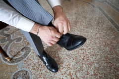 Groom shoes stock photo