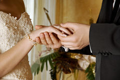 Groom putting a ring bride royalty free stock photography