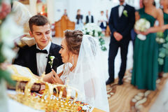 Groom putting a ring on bride`s finger during wedding Royalty Free Stock Image