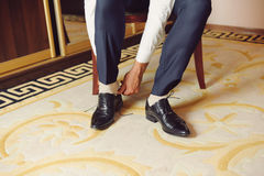 Groom Putting on Shoe Royalty Free Stock Photography