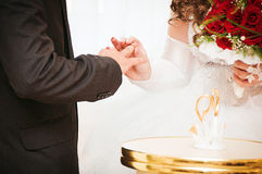 Bride putting a wedding ring Stock Photo