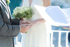 Groom putting wedding ring on bride`s finger. In wedding day Stock Photography
