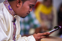 Groom reading the Taqliq Royalty Free Stock Images