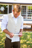 Groom Reading Vows for Wedding Stock Images