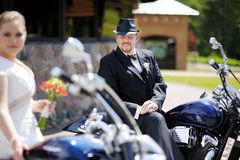Groom riding a motorcycle Royalty Free Stock Image