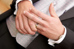 Groom Ring. A groom holding his wedding ring on his finger Stock Photos