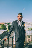 Groom on the roof of the city in a suit. With a plastron and buttonhole Stock Image