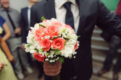Groom with Rose Bouquet Stock Photo