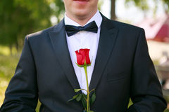Groom with rose. Groom with a bow tie and red rose Royalty Free Stock Photos