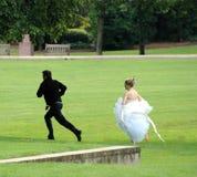 Groom Running Away. Royalty Free Stock Photo