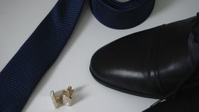 Groom`s accessories lying on a dark surface, wedding flatlay 1 stock footage