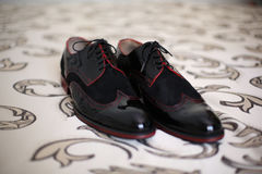 Groom`s black leather shoes. On the carpet, selective focus Royalty Free Stock Photo