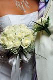 Groom's boutonniere and bride's flowers Stock Photos