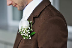 Groom's boutonniere closeup with raindrops Royalty Free Stock Images