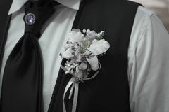 Groom's Boutonniere tie and brooch. Groom's corsage - Flower Arrangement, orchid, tie and brooch Royalty Free Stock Photography